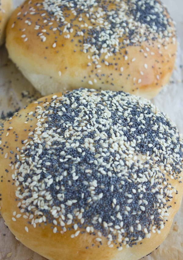 close up of a sesame and poppy seed topped soft burger bun