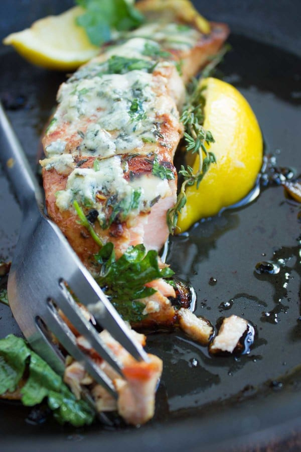 a fork tucking into a seared Salmon fillet with Blue Cheese topping
