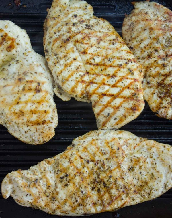 Chicken Breasts seasoned and on the grill.