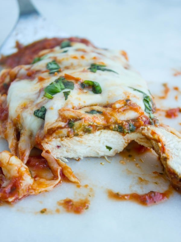 Grilled Chicken Parmesan cooked and sliced to see juicy chicken inside.