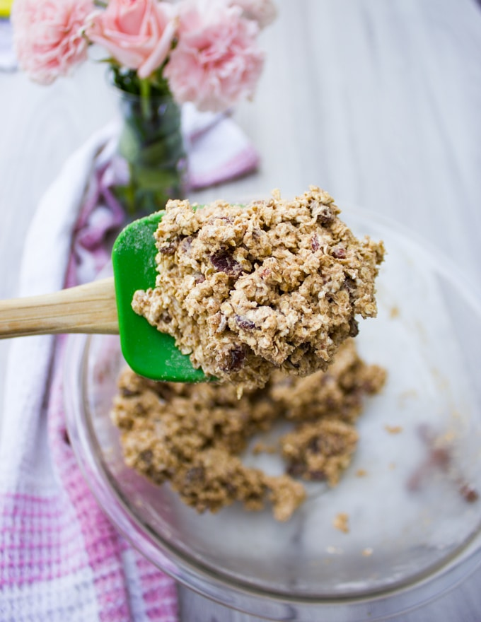 A spatula holding off the batter for the healthy oatmeal raisin cookie batter