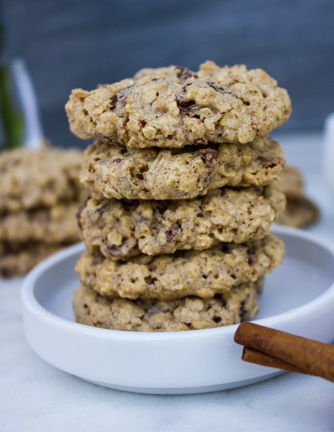 close up stack of healthy oatmeal cookies on a white plate
