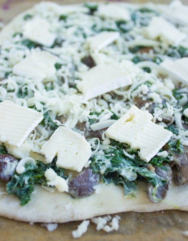 Kale Mushroom Brie Pizza ready to be baked