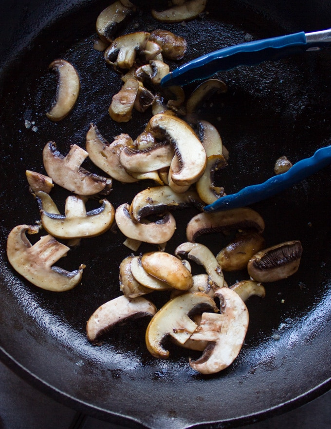 sliced Mushrooms cooking in the same skillet