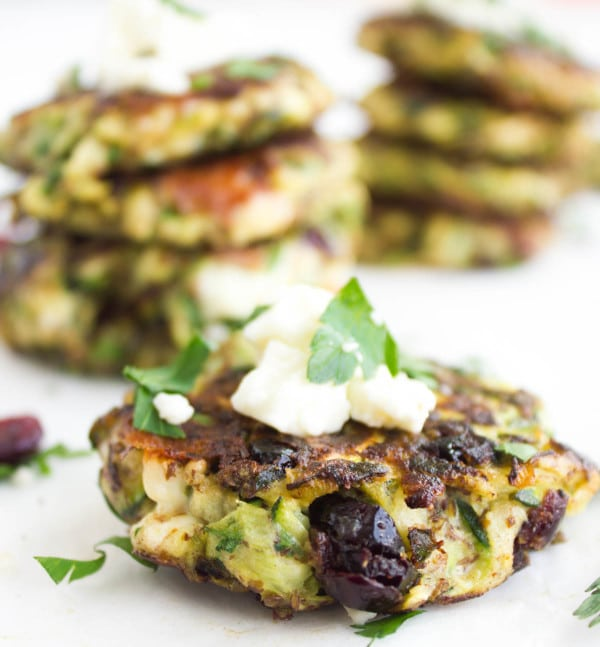 side view of Gluten-free Zucchini Fritter with cranberries and some crumbled feta on top