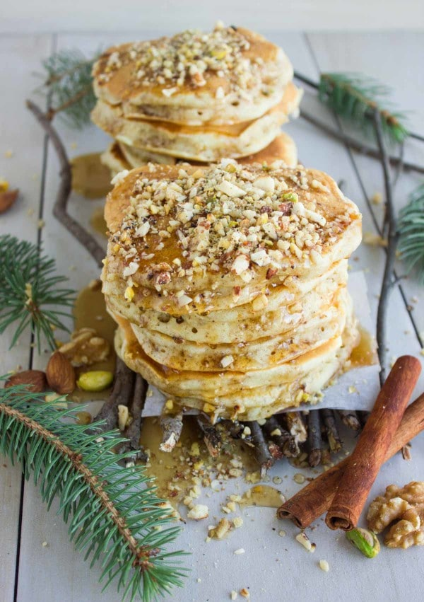 side view of two stacks of Baklava Pancakes with Maple Syrup and chopped pistachios on top