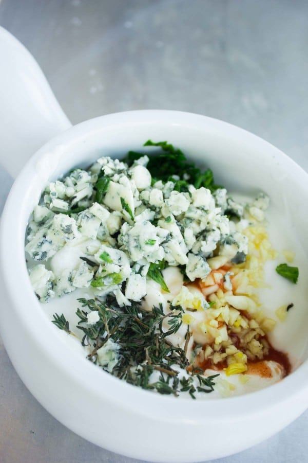 ingredients for Garlic Blue Cheese Dip in a white mortar