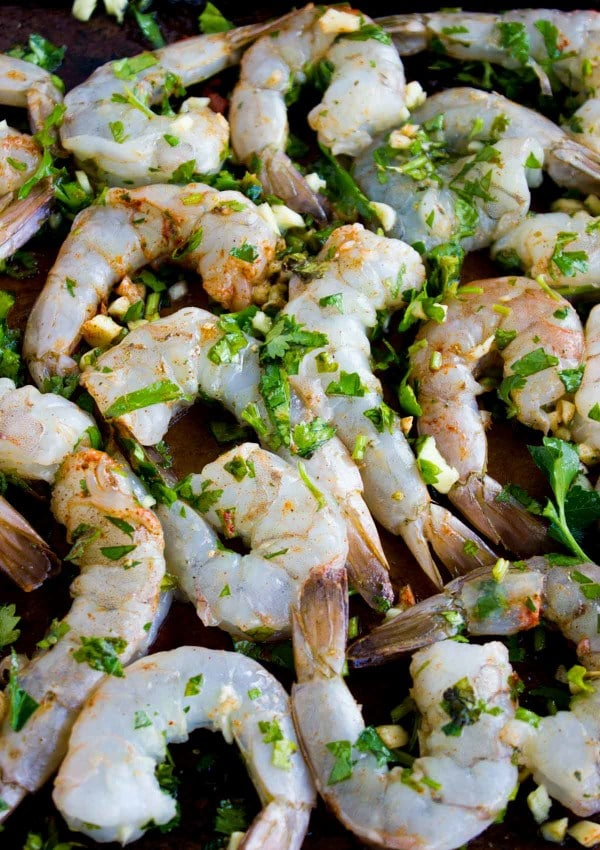 Whole Shrimp being tossed with olive oil and herbs