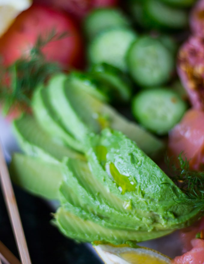 Close up of sliced avocados on the smoked salmon platter