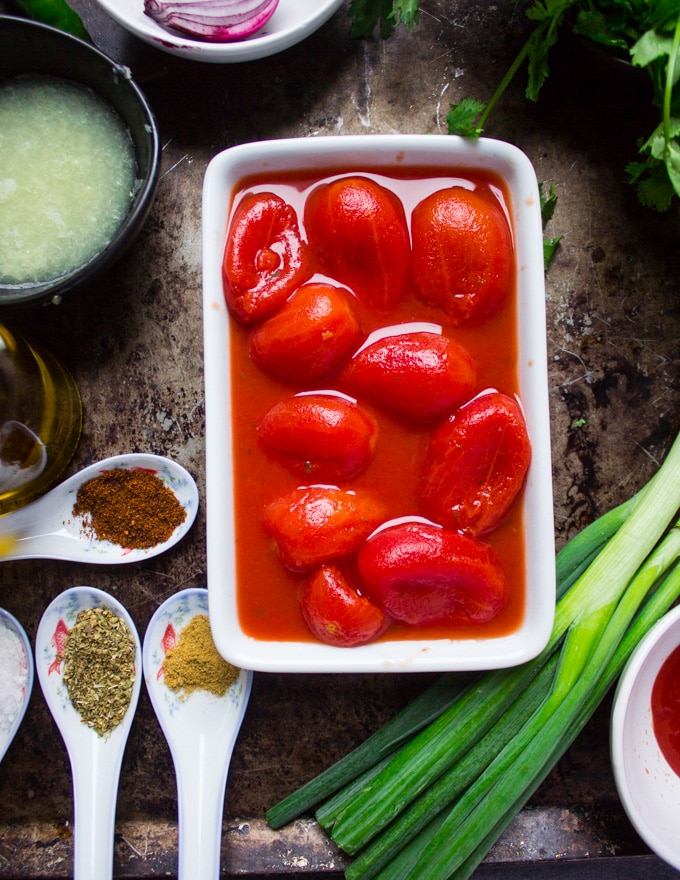 the whole tomatoes in a bowl