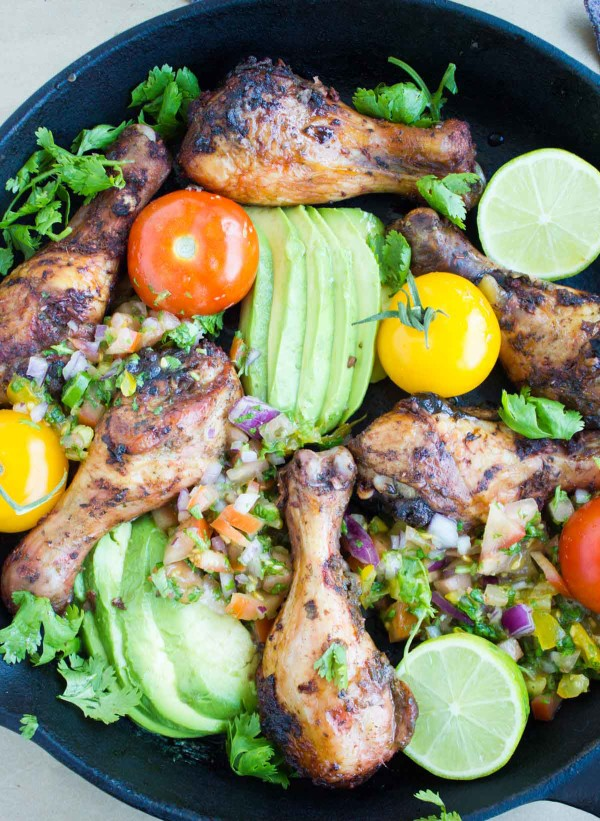 Salsa Avocado Roast Chicken Skillet garnished with fresh cilantro, tomatoes and avocado slices