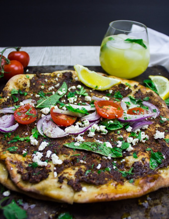 Close up Turkish pizza Lahmacun served with a cold drink and flat right out of the oven
