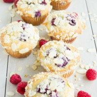Lemon Raspberry Almond Crunch Muffins on a white tabletop