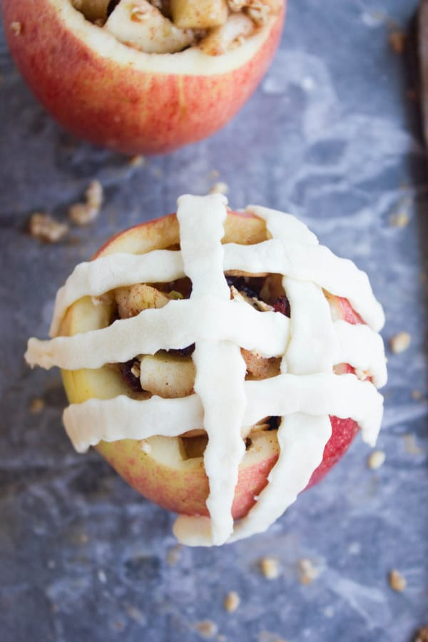 Apple Pie Stuffed Apples being topped with pie lattice