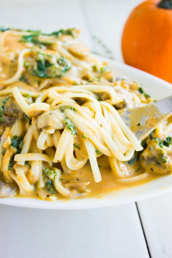 a fork twirling some Kale Mushroom Pumpkin Alfredo Pasta