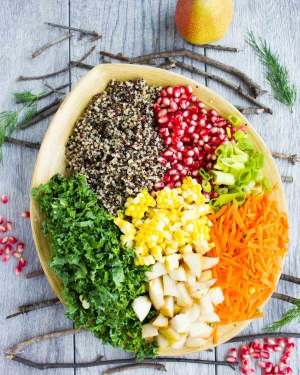 all ingredients for Quinoa Autumn Harvest Salad neatly piled up in a salad bowl