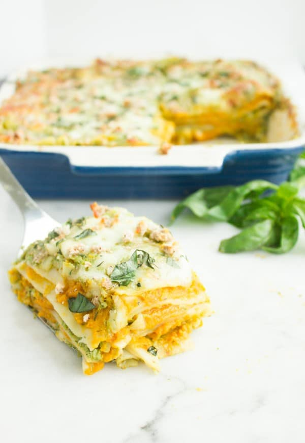 a serving of Butternut Squash Lasagna with Basil Bechamel served on a spatula