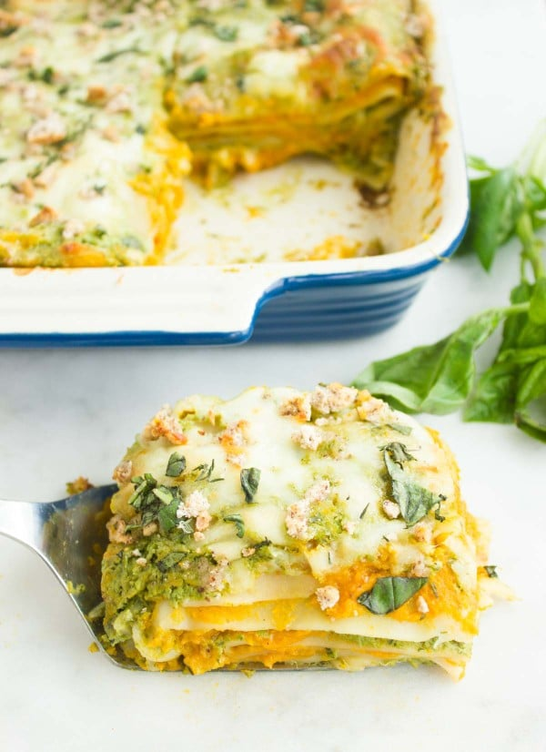 a piece of Butternut Squash Lasagna with Basil Bechamel served on a spatula