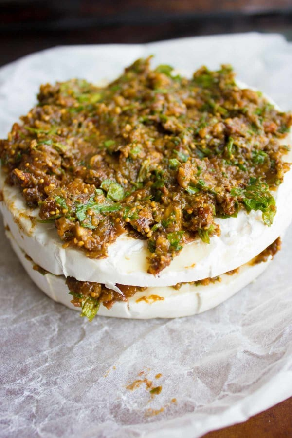assembled Brie stuffed with Fig Olive Tapenade ready to be baked