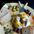 Fig Olive Tapenade Stuffed Brie. Easy fancy stuffed whole brie with a quick fig olive tapenade that will impress your friends in a flash! www.twopurplefigs.com