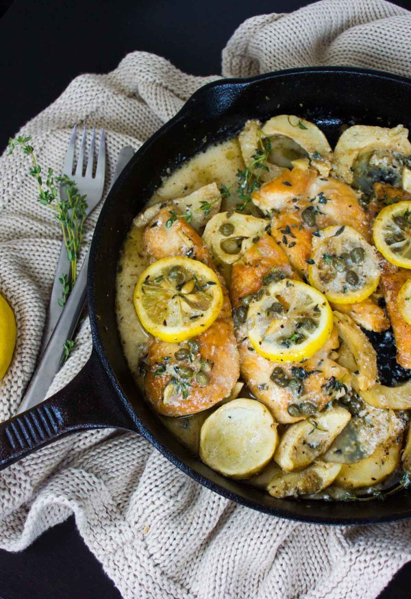Lemon Caper Artichoke Chicken Piccata in a black skillet