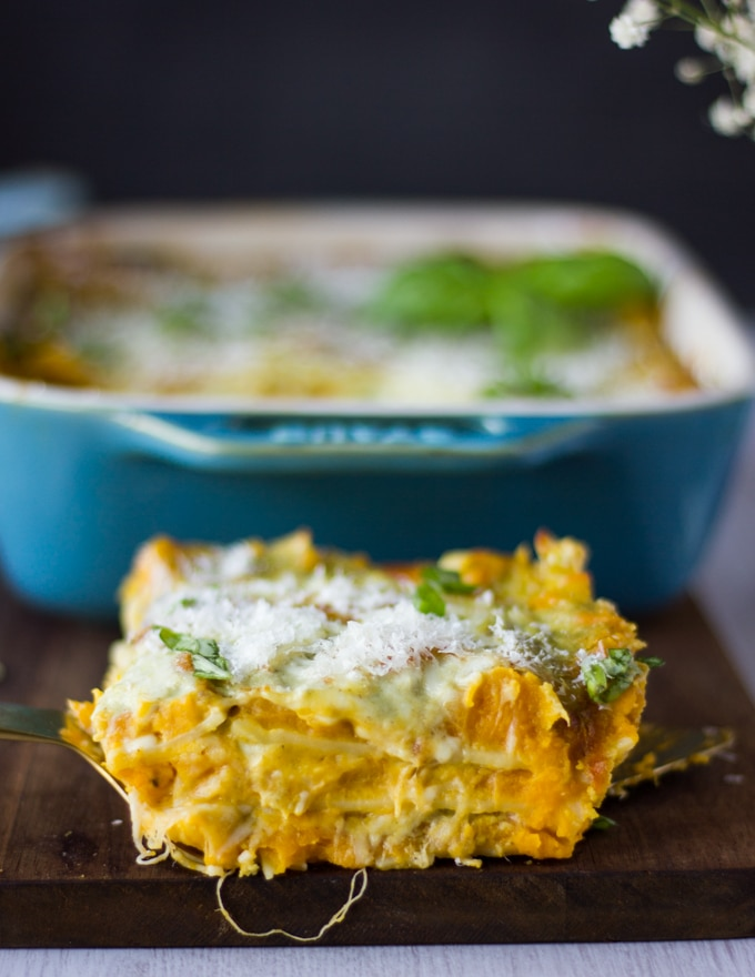 detailed close up of one slice of lasagna showing the layers of butternut squash, basil sauce and cheeses