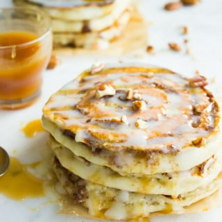 Banana Swirl Cinnamon Roll Pancakes. Here's the BEST pancake you'll ever make--fluffy, light as air pancakes with a banana pecan cinnamon swirl! Easy, Scrumptious cross between CINNAMON ROLLS+BANANA BEAD+PANCAKES..Get the Step by Step recipe and photos! www.twopurplefigs.com