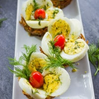 Easter Egg Tart Potato Nests on a white rectangular plate