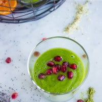 Hemp Matcha Kale Power Boosting Smoothie sprinkled with pomegranate seeds