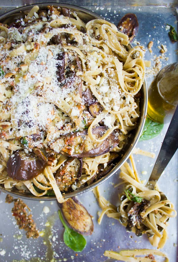 Skinny Eggplant Parmesan Pasta in a bowl topped with lots of grated parmesan