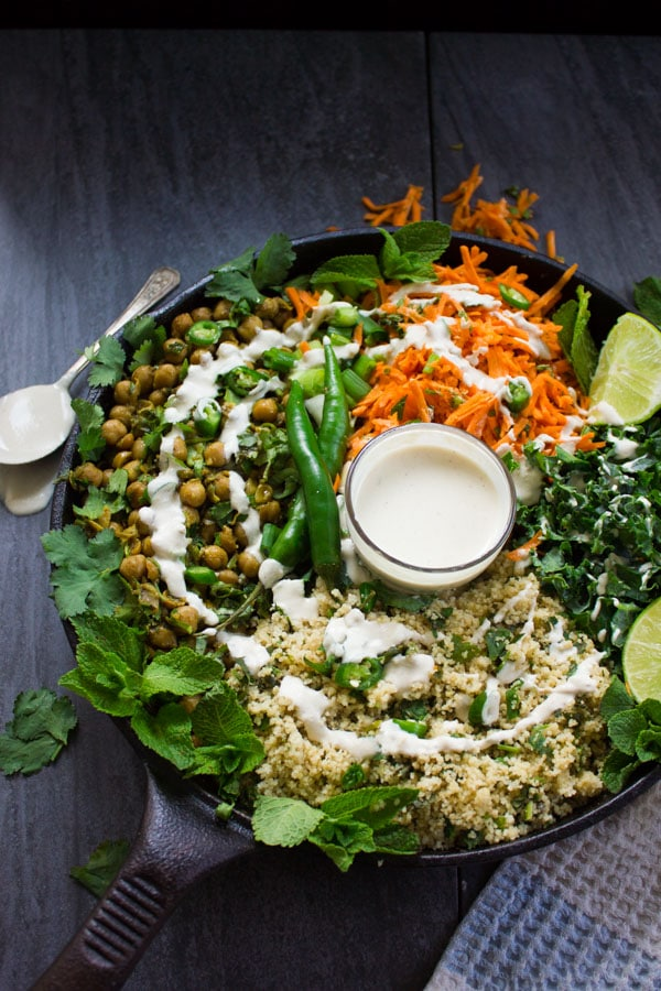 Tahini sauce drizzled over all the vegan Moroccan couscous salad