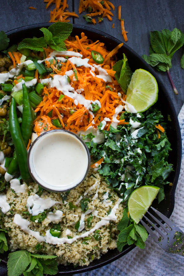 close up of the carrot mint salad and kale drizzled with tahini sauce