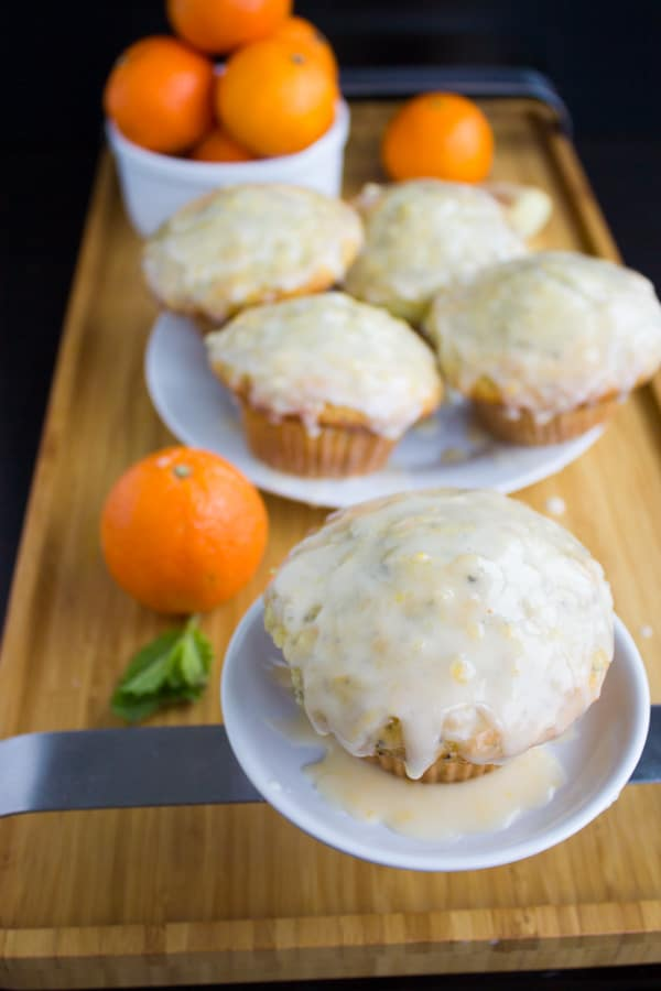 Glazed Lemon Poppy Seed Muffins with Clementine and Ginger on two white plates