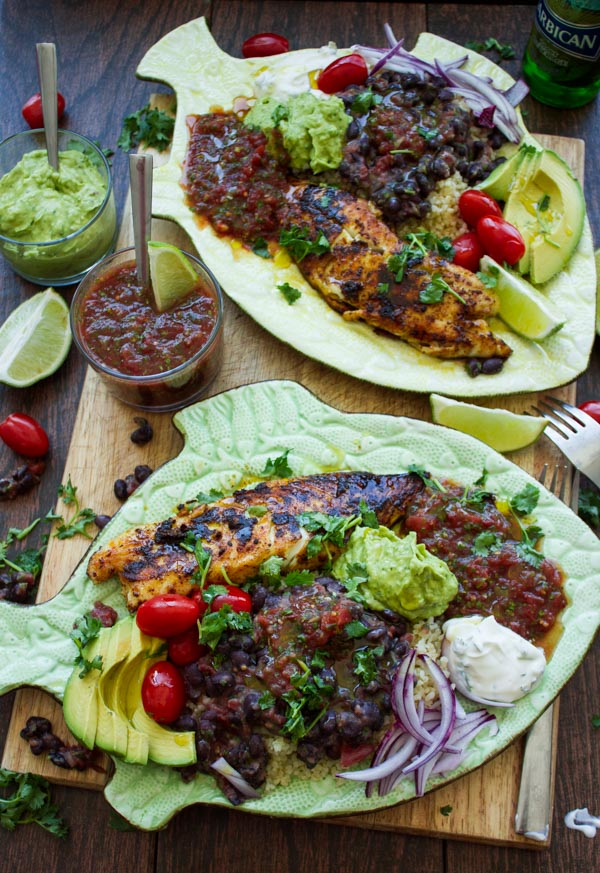 pan-fried tilapia fish fillets crusted with Mexican spices and served with black beans, guacamole and salsa