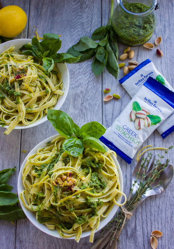 Fettuccine With Pistachio Pesto Sauce. This insanely delicious pasta dish comes together in 15 mins with plenty of pistachios, basil and spinach! It's pasta perfection! Serve it hot or cold--a crowd pleaser time after time! www.twopurplefigs.com
