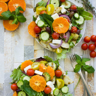Orange Lentil Greek Salad. The perfect way to jazz up your Greek salad--make it hearty, filling, nutritious and absolutely YUMMY! Dressed up in an orange olive homemade Greek salad dressing, it's a perfect full meal salad, bbq salad, potluck, picnic, lunch, anything salad! Vegan and gluten free too--make this recipe today!