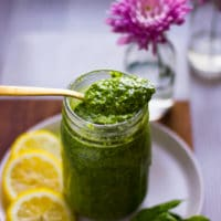 a spoonful of pistachio pesto over a jar of finished pistachio pesto
