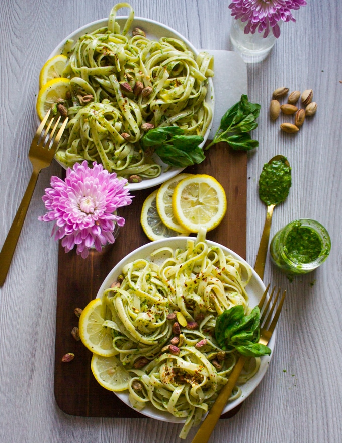 Pesto pasta recipe on a plate with a spoonful of sauce, second plate in background