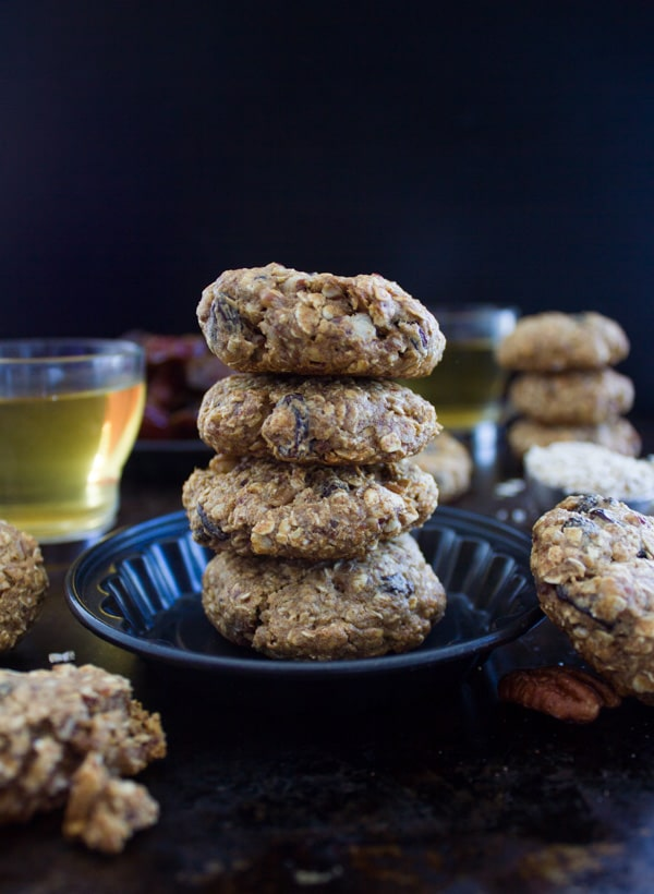 side view of a stack of Vegan Oatmeal Raisin Cookies with almond butter and dates