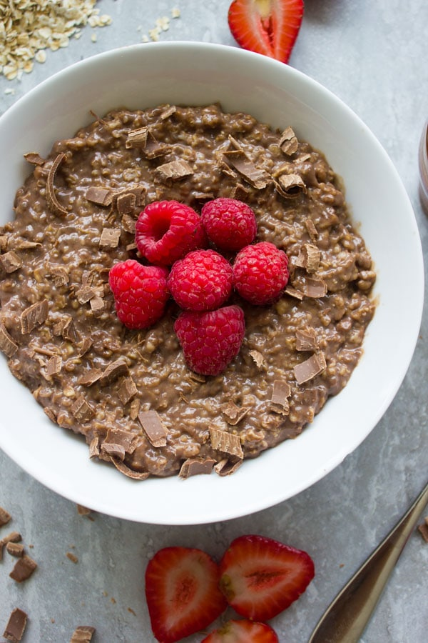 Chocolate Oatmeal Breakfast Bowl. the best way to start your morning--filling, healthy, let chocolate-y--get the recipe with ideas and tips to make this into a healthy breakfast bowl or a chocolate dessert! www.twopurplefigs.com
