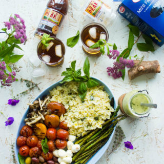 Summer Pasta Salad Platter With Sweet Tea Dressing. This will be our go to BBQ, picnic, potluck and all Summer long favorite! Platter style make your own pasta salad and an amazing herb sweet tea dressing to drizzle, plus get tips for throwing the perfect BBQ party! #SummerTastes www.twopurplefigs.com