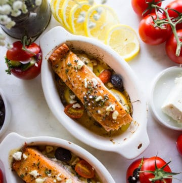Finished Baked Salmon with Greek Dressing in ramekins for serving.