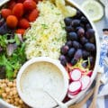 Lemon Cauliflower Rice Salad With Yogurt Dressing. Quick, easy and super delicious salad made with lemon cauliflower rice, plenty of veggies, fruits and goodies. A bright herb yogurt sauce drizzled on top to brighten the salad --a real crowd pleaser and a favorite for potluck! www.twopurplefigs.com