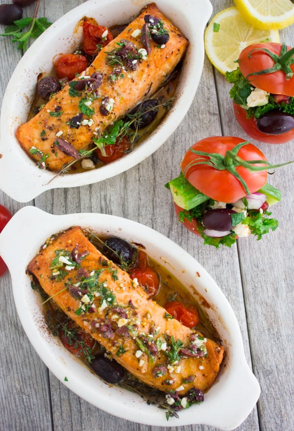 overhead shot of two individual casseroles with Baked Salmon With Greek Dressing