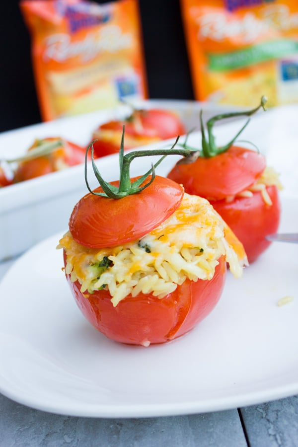 Close-up of Broccoli Rice Casserole Stuffed Tomatoes on a white plate