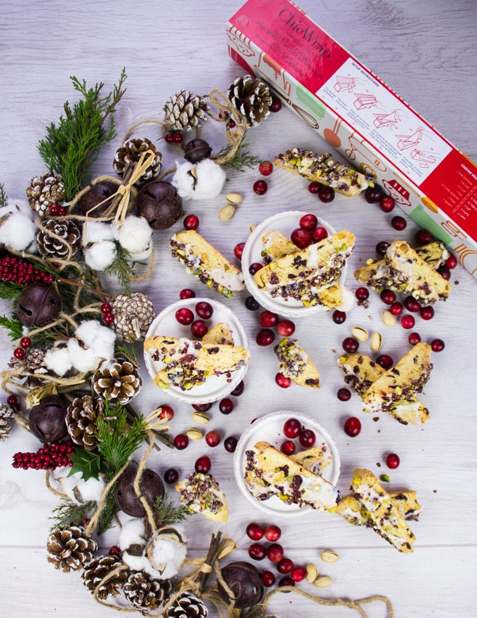 A Holiday wreath surrounded by a big batch of Holiday Biscotti