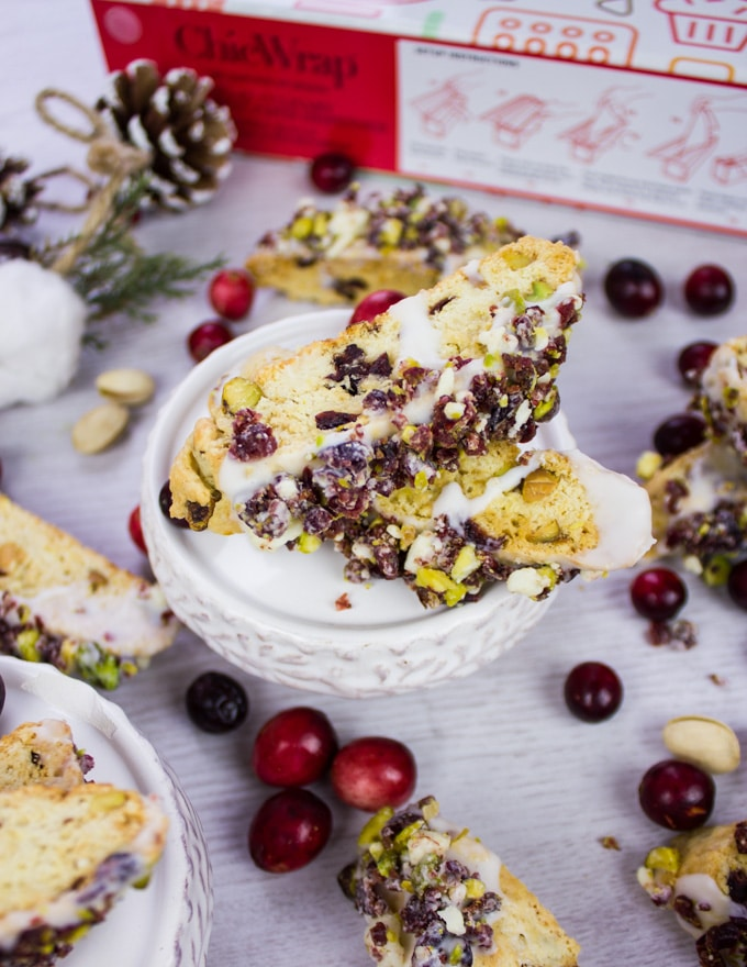 Cranberry Pistachio Biscotti recipe dipped in white chocolate and sprinkled with cranberries and pistachios