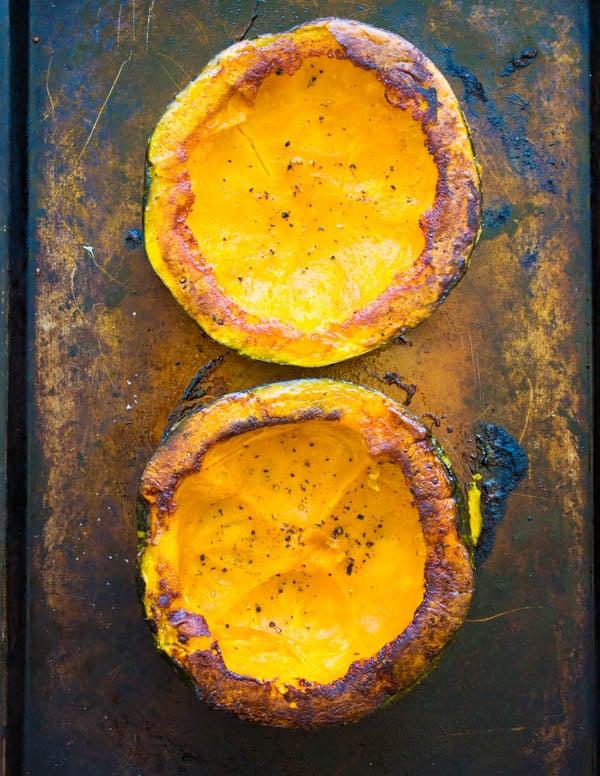 oven roasted halved kabocha squash on a baking sheet