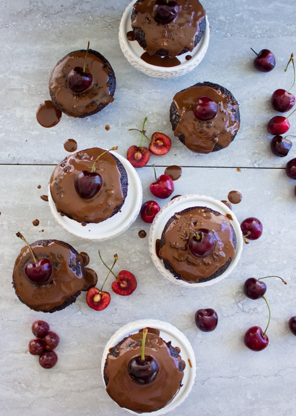 Mini Black Forest Cupcakes topped with chocolate glaze and fresh cherries