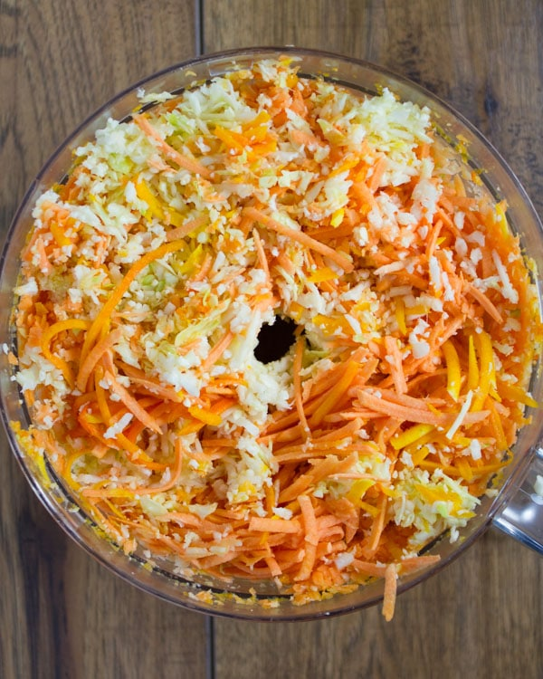 shredded vegetables in the bowl of a food processor